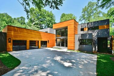 Gary Jobe Builders custom contemporary home style black wood full-view aluminum glass garage doors