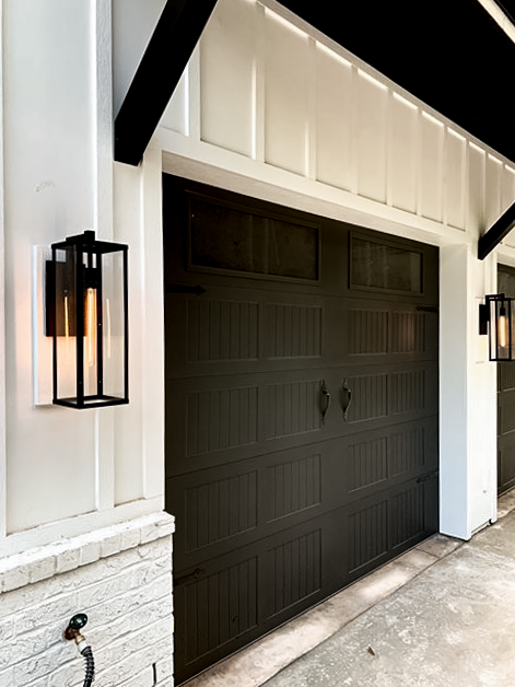 IC Construction LLC Stamped Carriage House Garage Door in Black on Modern Farmhouse Custom Home