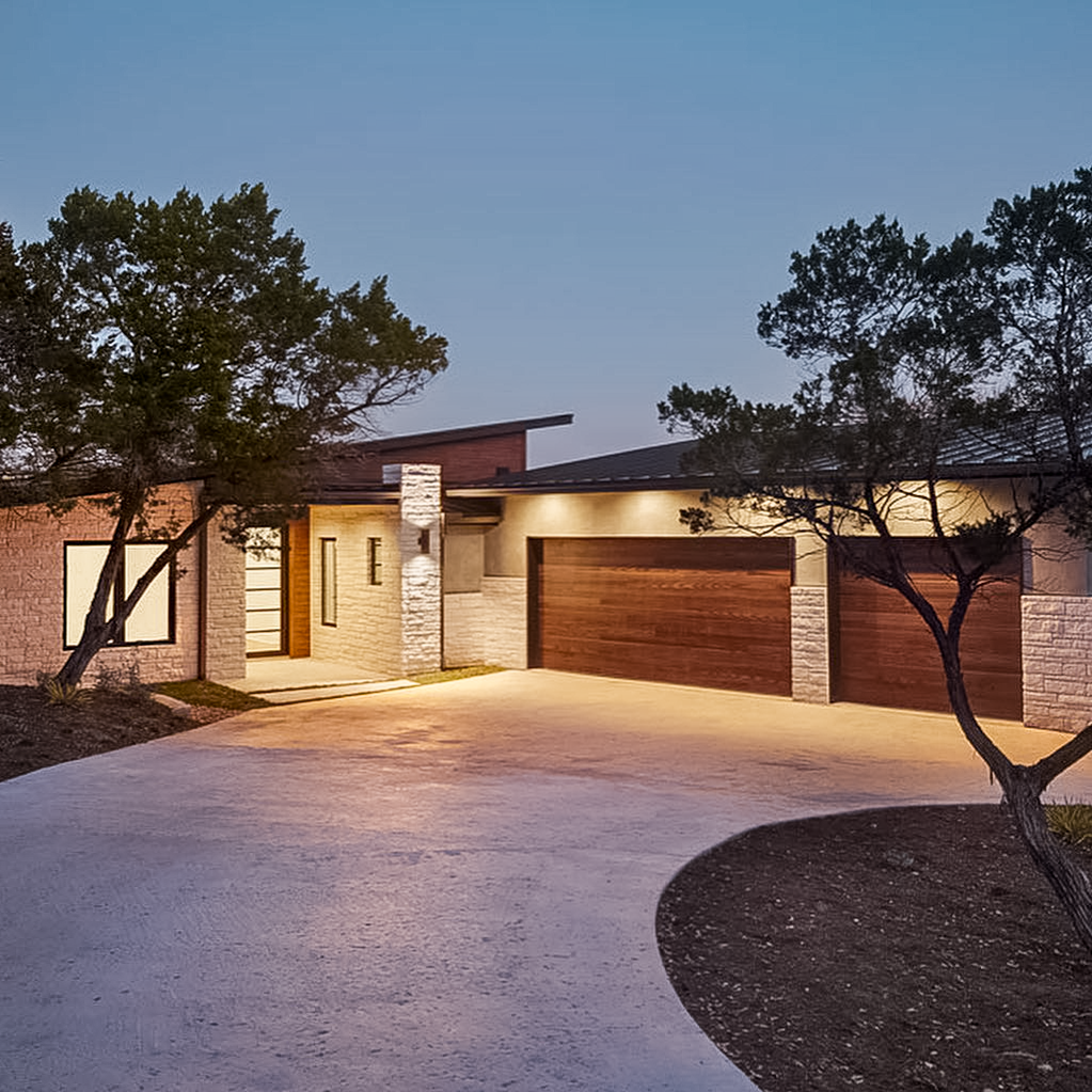 Younger Homes planks garage door on modern custom contemporary home