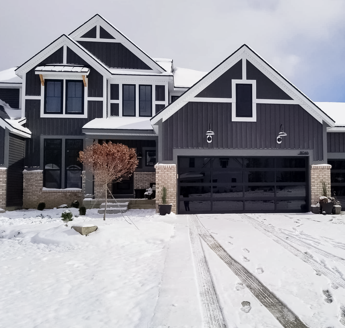 @houseofhemingway on instagram full-view aluminum garage door with tinted glass on modern craftsman home